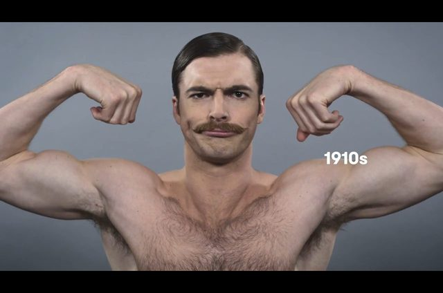 Rok 1910 - panowie nosili sumiaste wąsy i czesali się z przedziałkiem.
