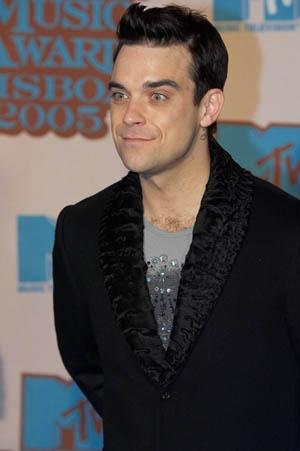 Robbie Williams i jego seksowna różowa piżamka (FOTO)