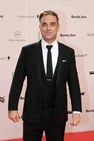 Robbie Williams zrobił tę głupią minę, ponieważ… [VIDEO]