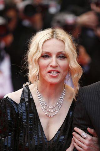 Madonna nie chce mówić o pieniądzach dla Guya