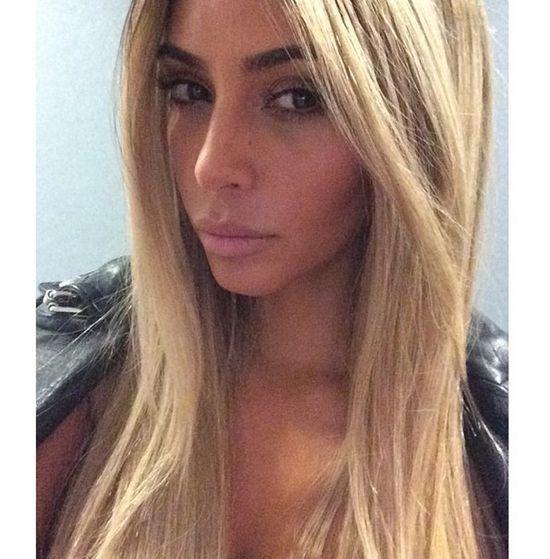 Kim Kardashian w blond peruce.