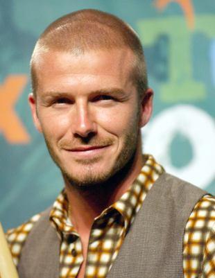 David Beckham z pięścią na fotoreportera