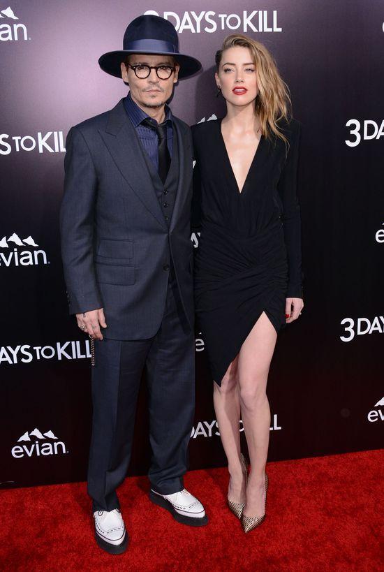 Zakochani Johnny Depp i Amber Heard całują się na ściance
