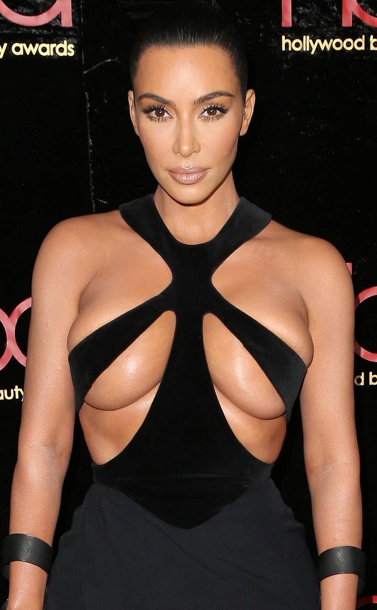 Kim Kardashian turns heads at the 5th Annual Hollywood Beauty Awards wearing sexy strapped dress Kim Kardashian West