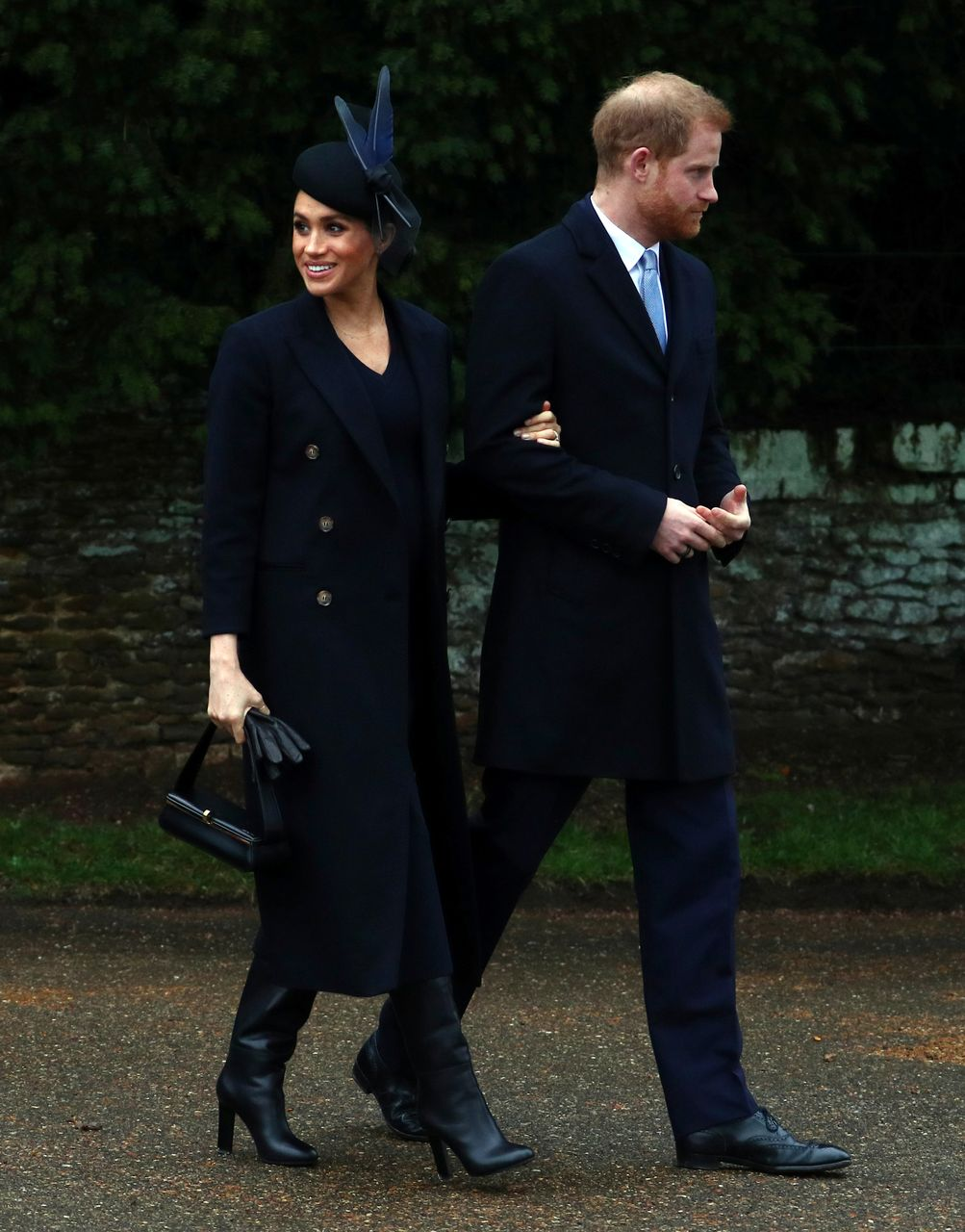 Britain's Prince Harry, Duke of Sussex and Meghan, Duchess of Sussex leave St Mary Magdalene's church after the Royal Family's Christmas Day service on the Sandringham estate in eastern England