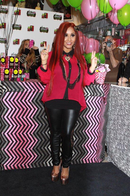 Czerwonowłosa Snooki promuje perfumy (FOTO)