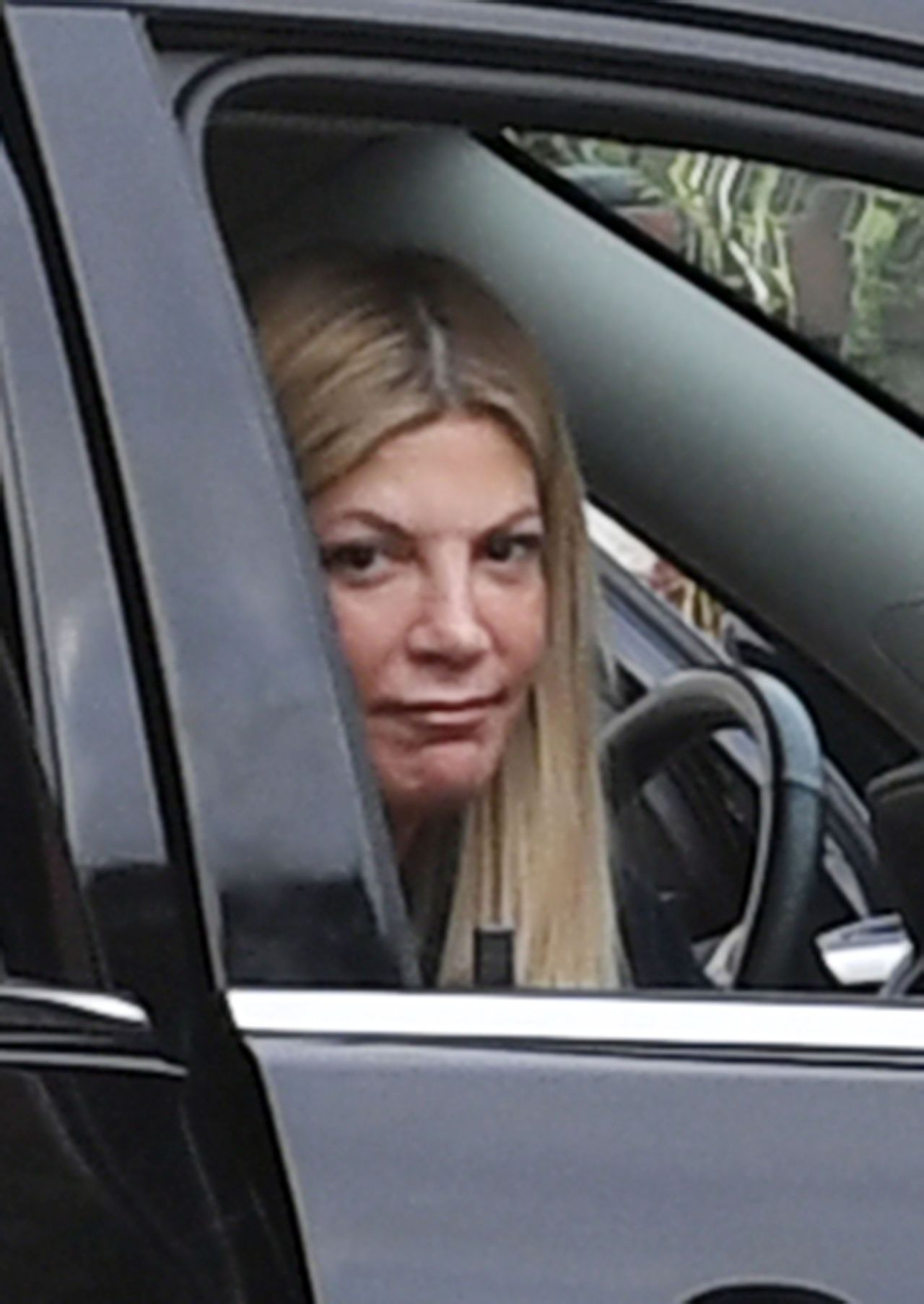 EXCLUSIVE: Tori Spelling cries in her car after learning about Luke Perry's sudden death