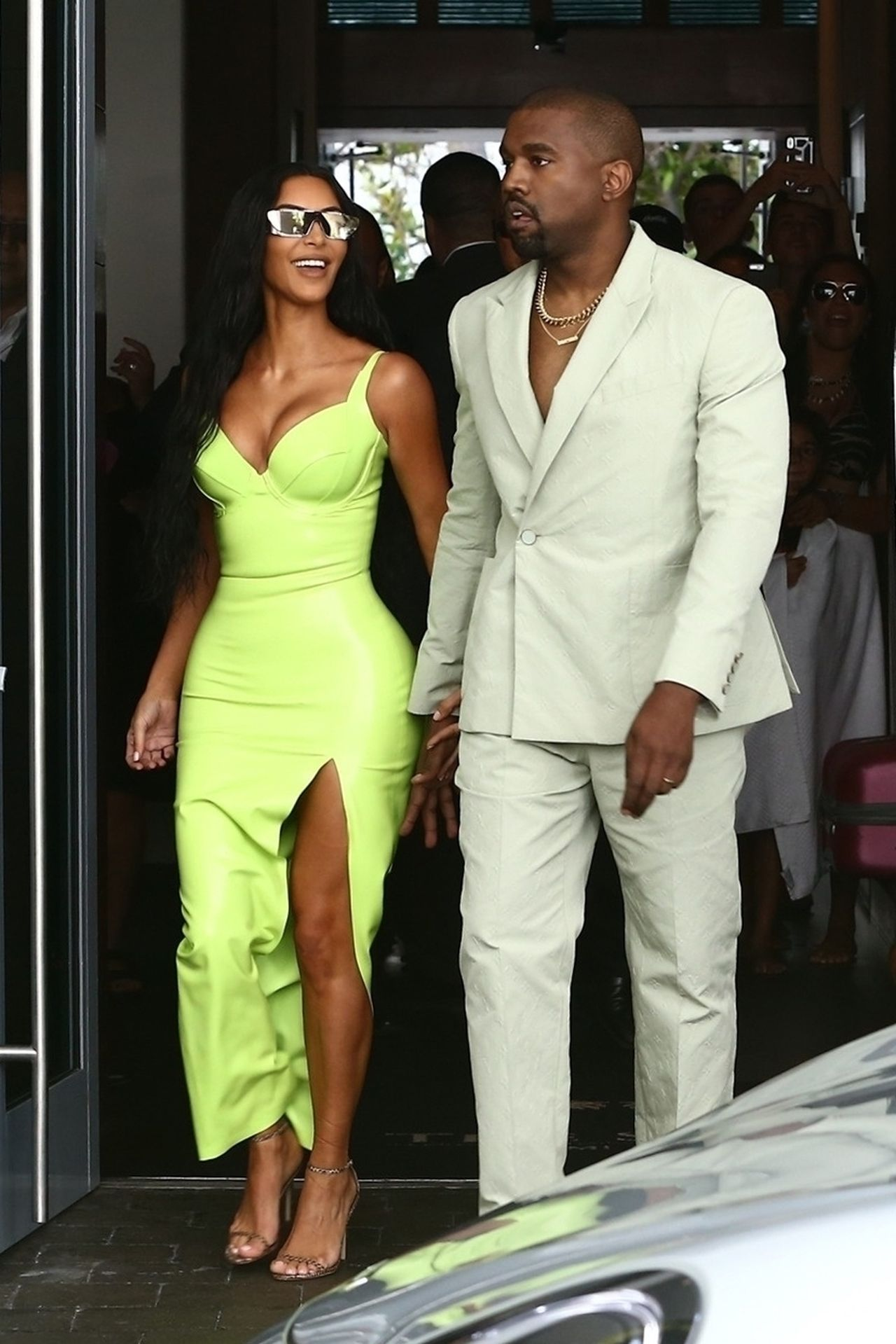 Kim Kardashian and Kanye West show off her unique wedding guest looks Kim Kardashian, Kanye West