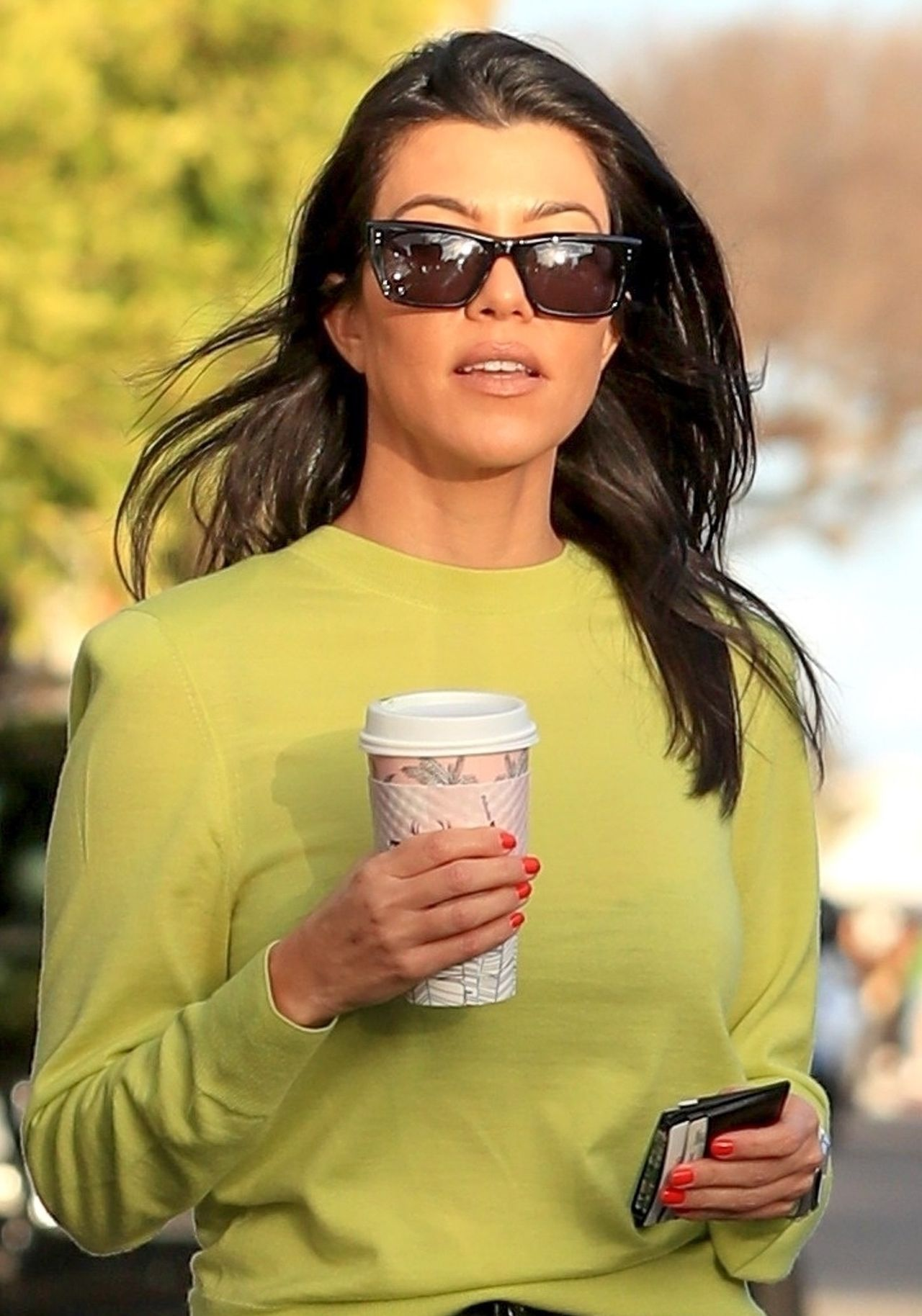 *EXCLUSIVE* Kourtney Kardashian goes on coffee run with friend shining in neon sweatshirt Kourtney Kardashian
