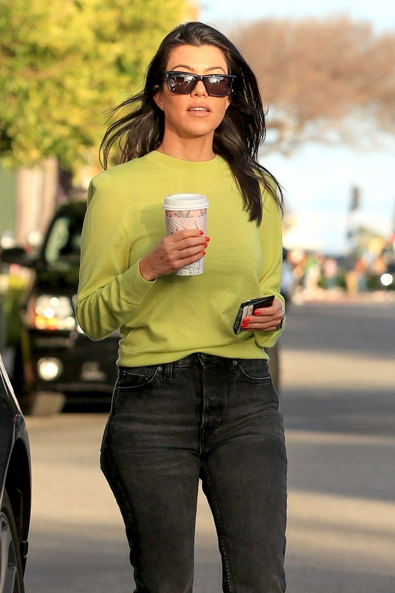 *EXCLUSIVE* Kourtney Kardashian goes on coffee run with friend shining in neon sweatshirt Kourtney Kardashian