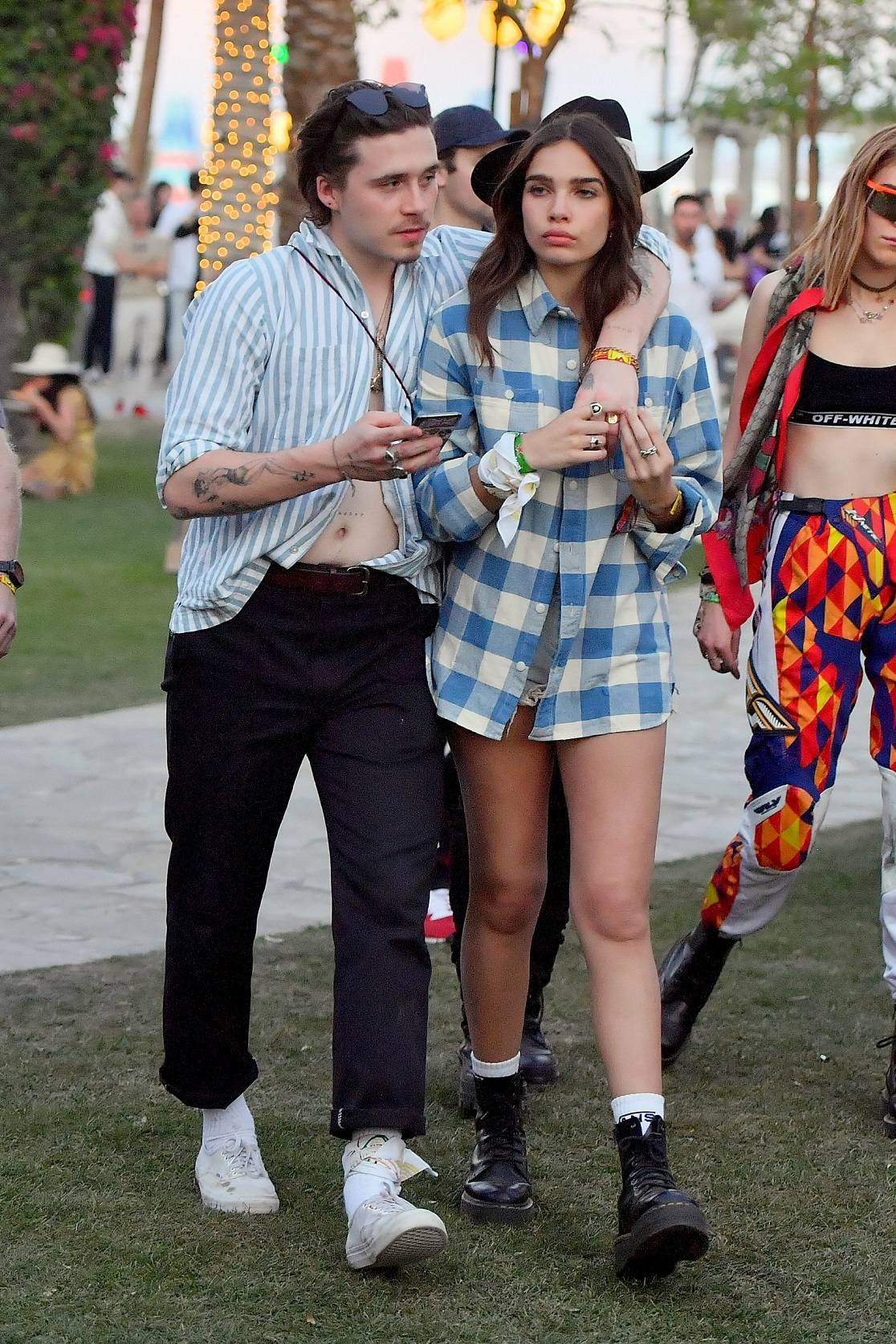 EXCLUSIVE: Brooklyn Beckham and his girlfriend Hana Cross chow down on some food at Coachella