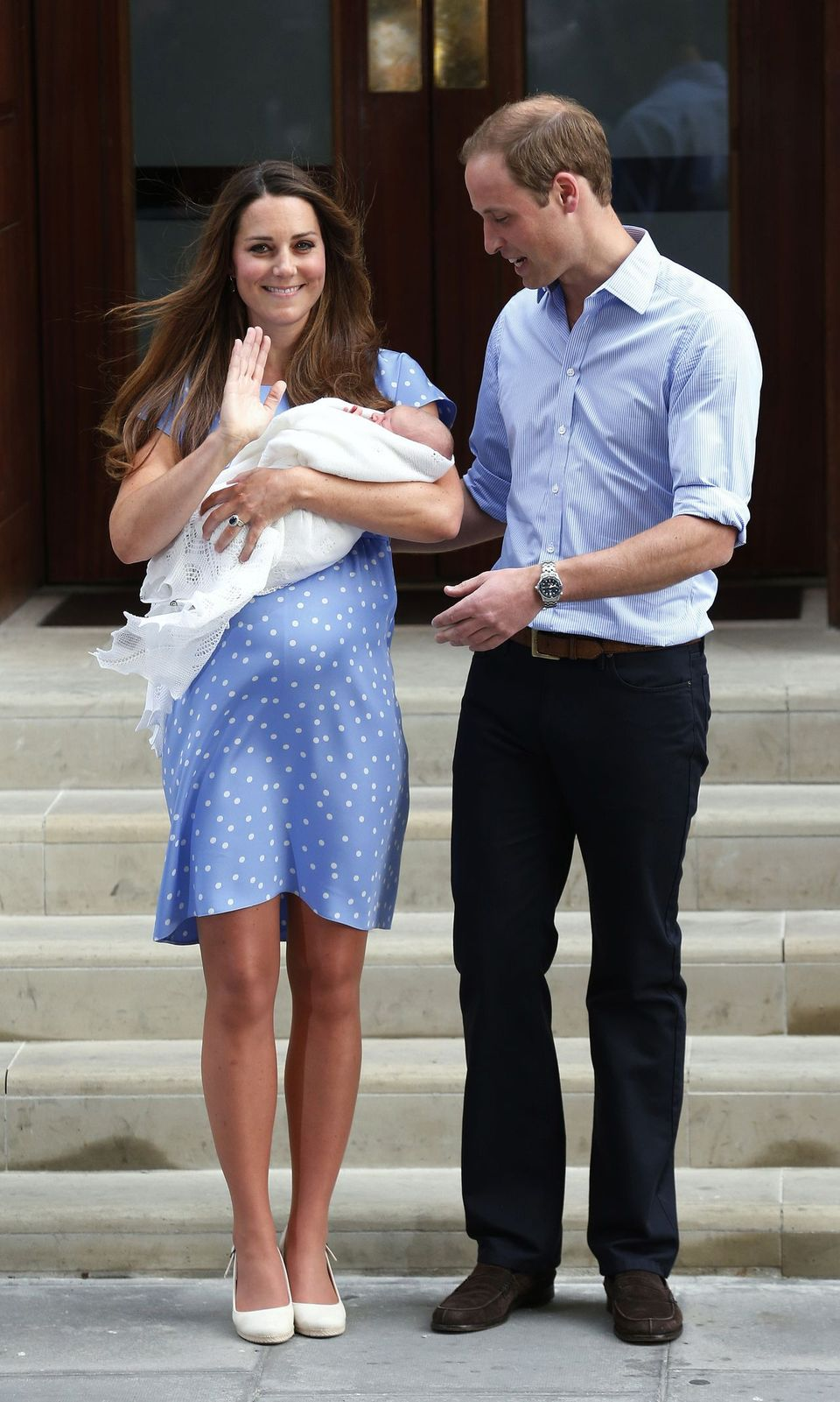 File photograph of Britain's Prince William and his wife Catherine, Duchess of Cambridge with their baby son, outside the Lindo Wing of St Mary's Hospital, in central London