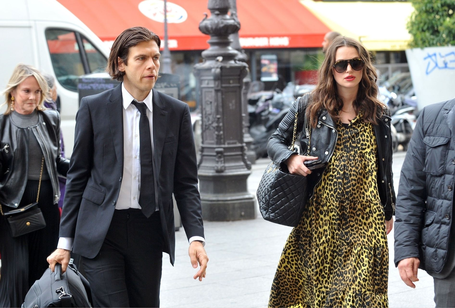 Pregnant British actress Keira Knightley pictured with husband James Righton in Paris.