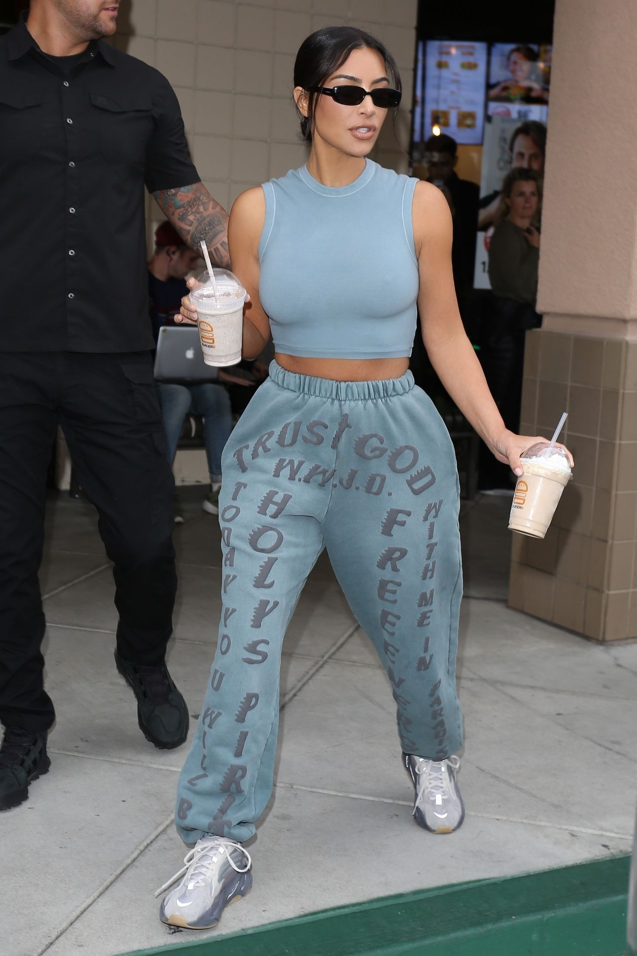 *EXCLUSIVE* Kim Kardashian leaves Burger IM with two milkshakes in hand and midriff on display!