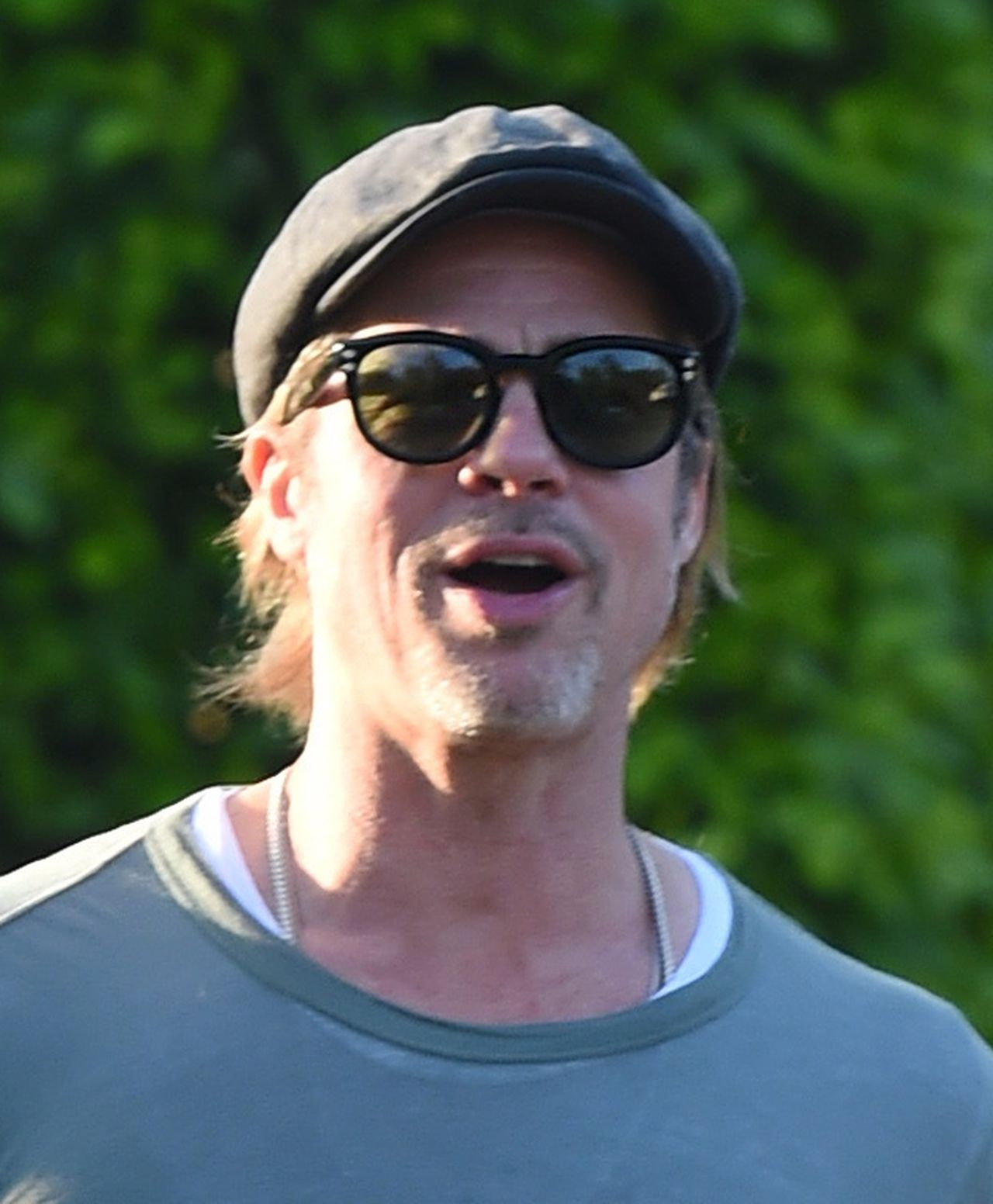 PREMIUM EXCLUSIVE - This is the moment Brad Pitt smiles cheekily as he is asked on camera the question that the world wants to know: Are you getting back with Jennifer Aniston?