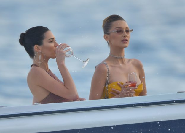 Kendall Jenner and Bella Hadid  drinking champagne on a yacht during Monaco Grand Prix