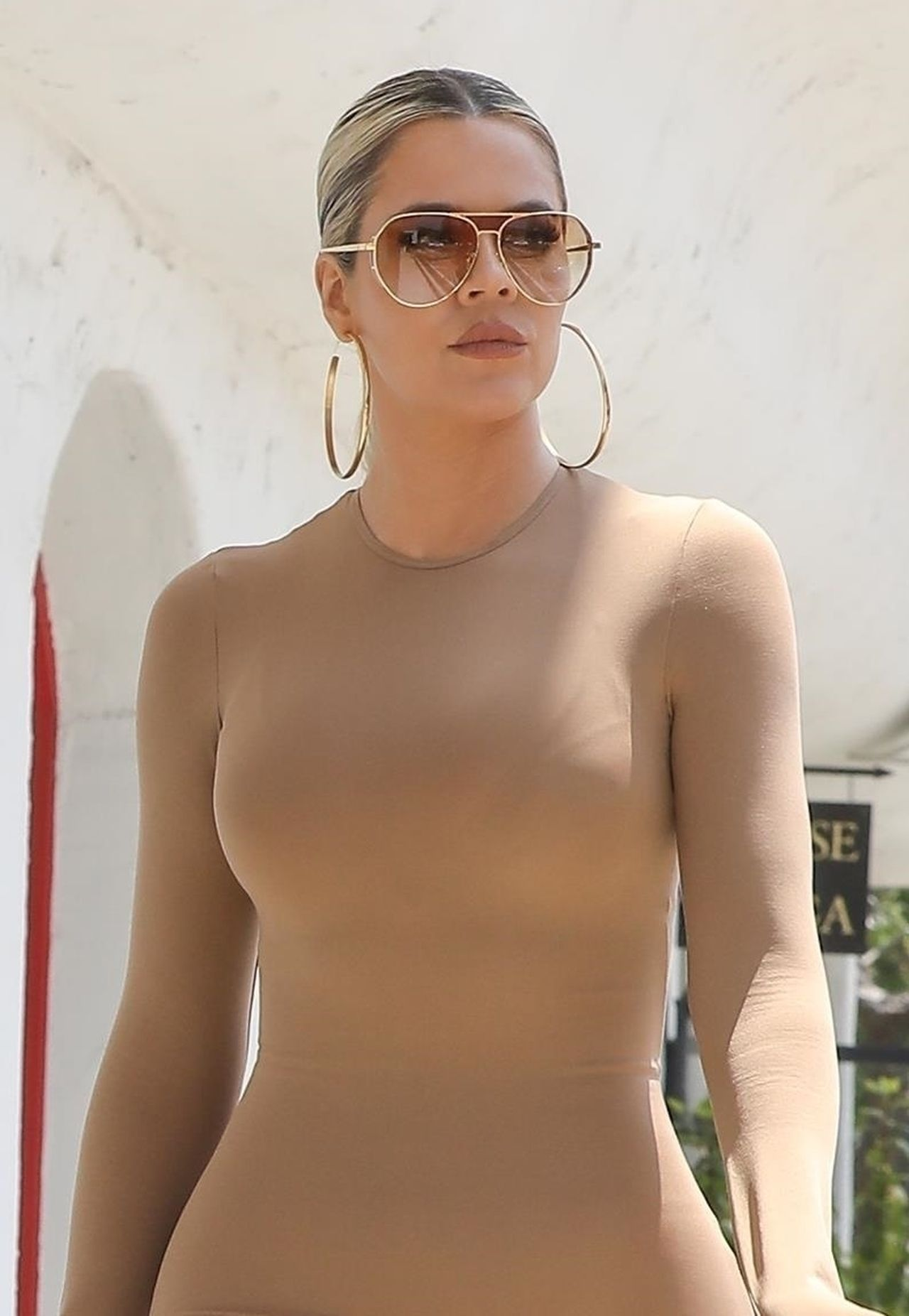 *EXCLUSIVE* Khloe and Kim Kardashian stun in skintight maxi dresses while out with Scott Disick at Malibu toy store