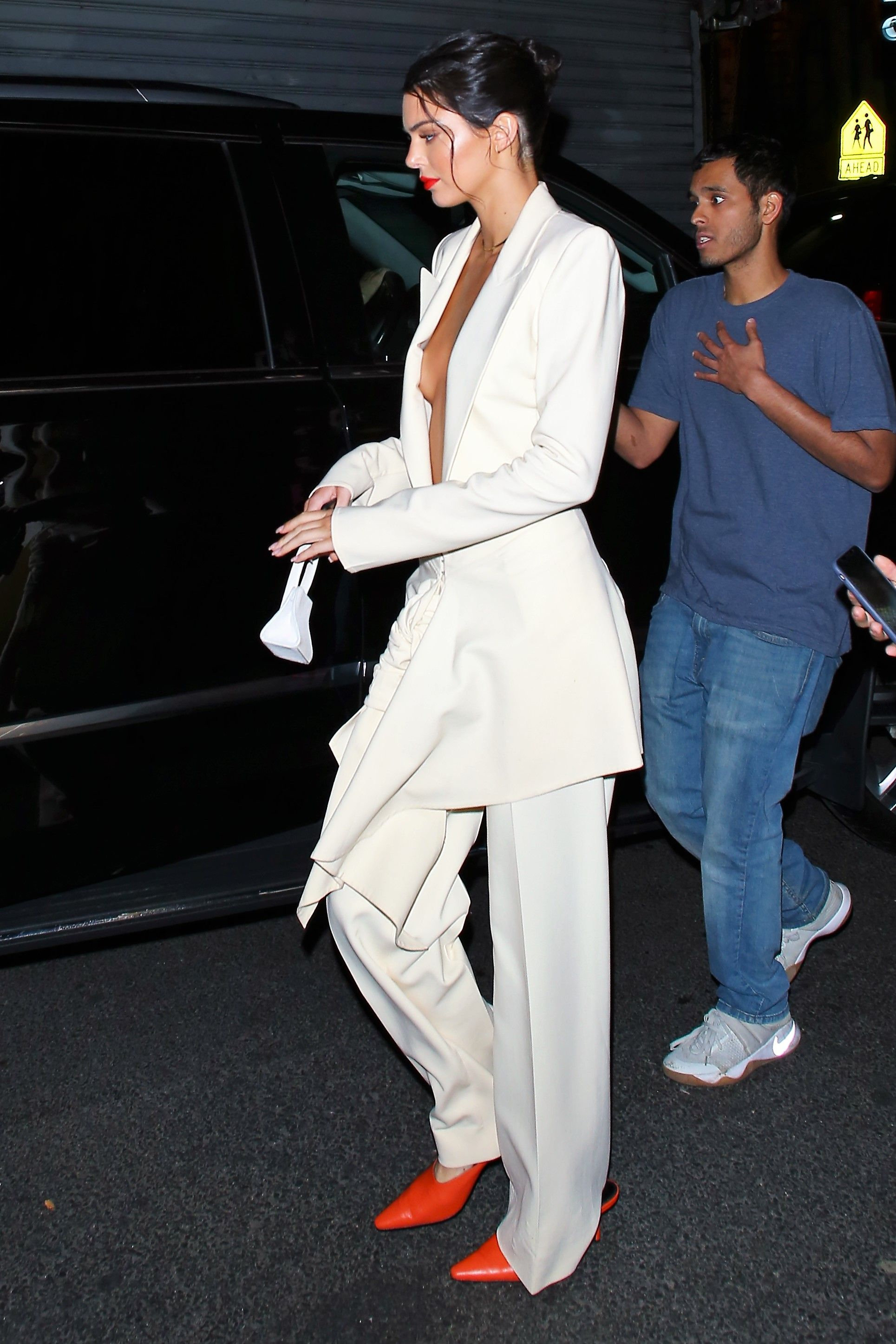 Kim Kardashian Is Striking In Yellow For Family Dinner With Kendall, Kylie, And Mom Kris