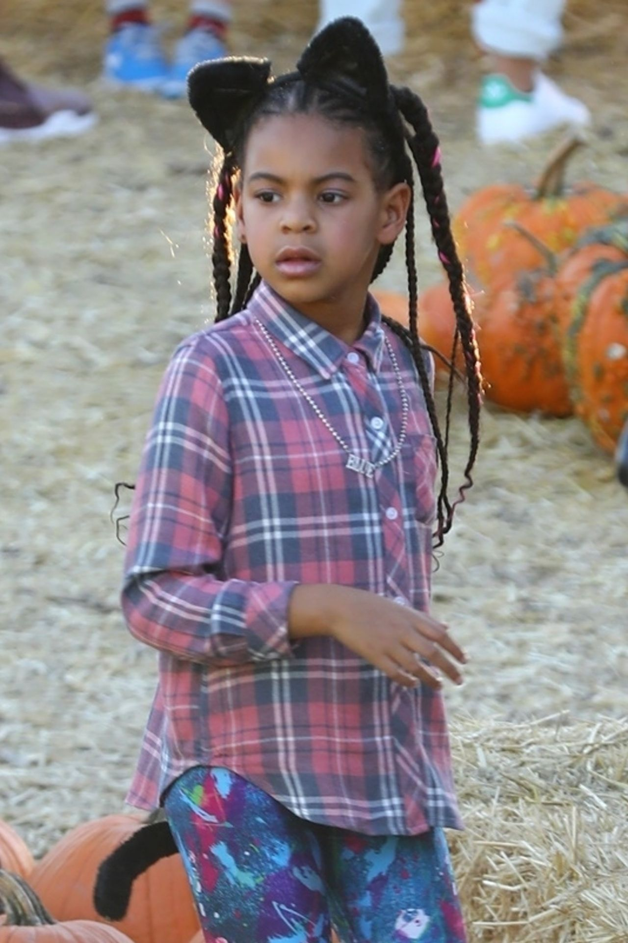 *EXCLUSIVE* Blue Ivy Carter enjoys a pony ride at the pumpkin patch with friends