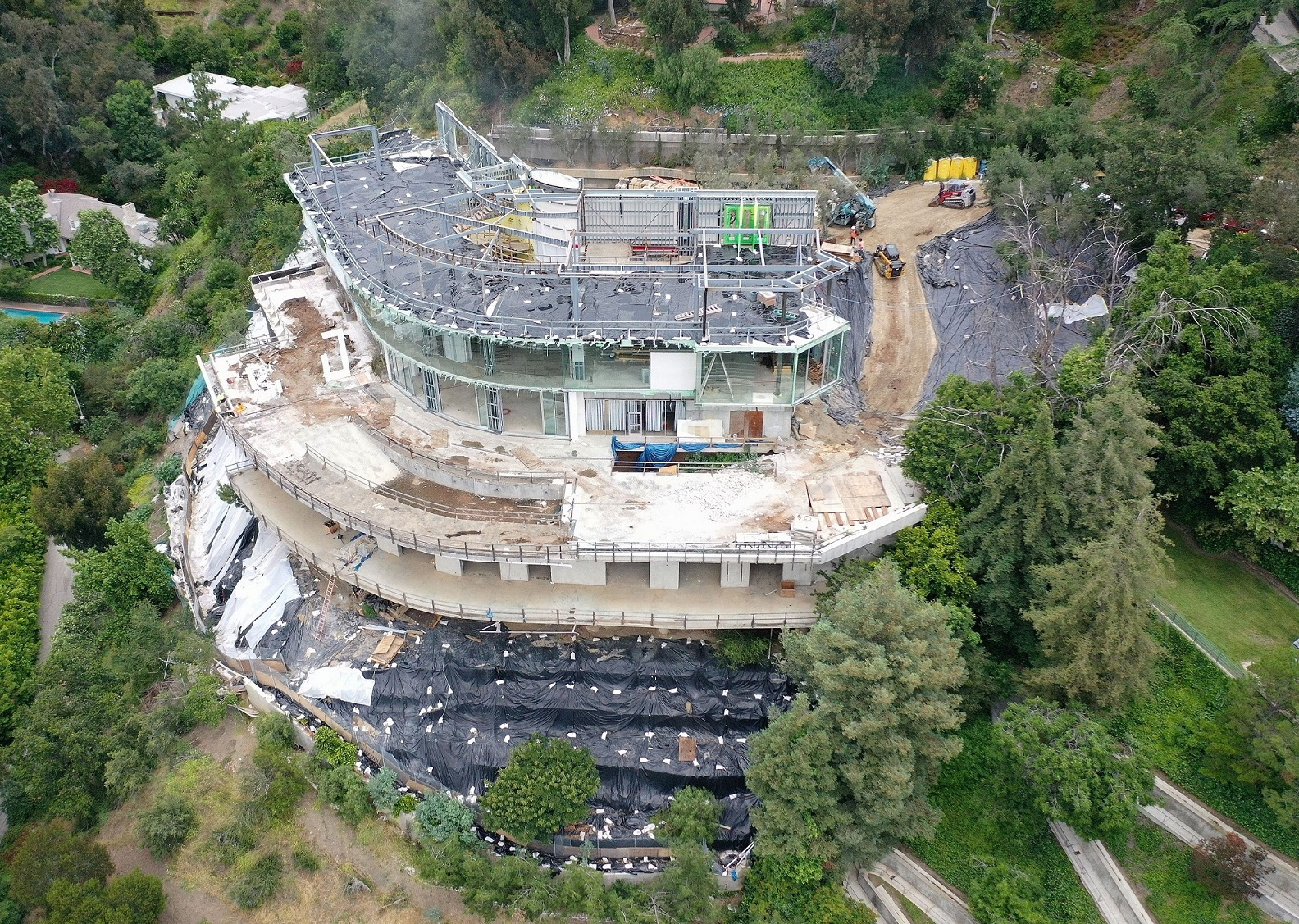 EXCLUSIVE: Mohamed Hadid starts to tear down his Bel Air mega Mansion!