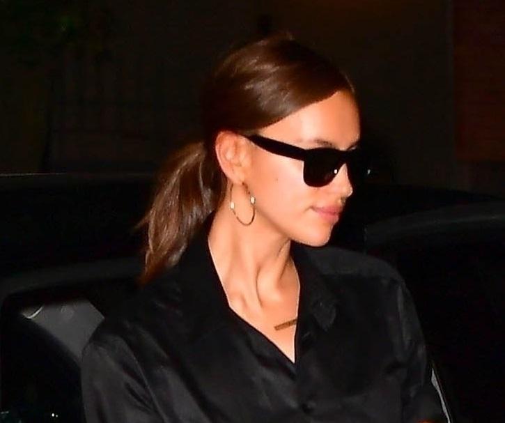 *EXCLUSIVE* Irina Shayk slips out in dark sunglasses under an umbrella in the Big Apple