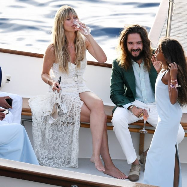 Heidi Klum, dazzles in bridal-inspired lace dress as she kisses husband Tom Kaulitz, on boat in Capri ahead of their second wedding ceremony