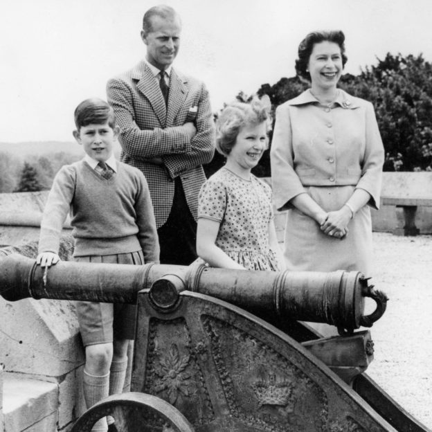 Queen Elizabeth II with her husband Prince Philip and their children on a rooftop