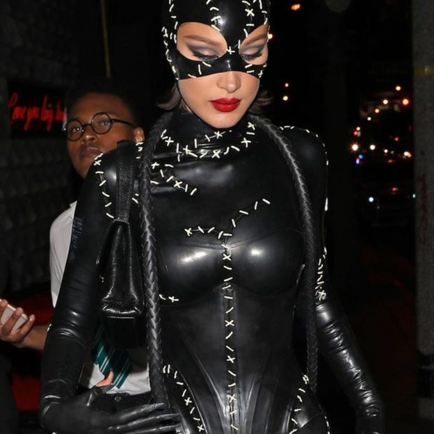 EXCLUSIVE: Bella Hadid channels cat woman from the movie Batman Returns as she leaves Kendall Jenner's 24th birthday