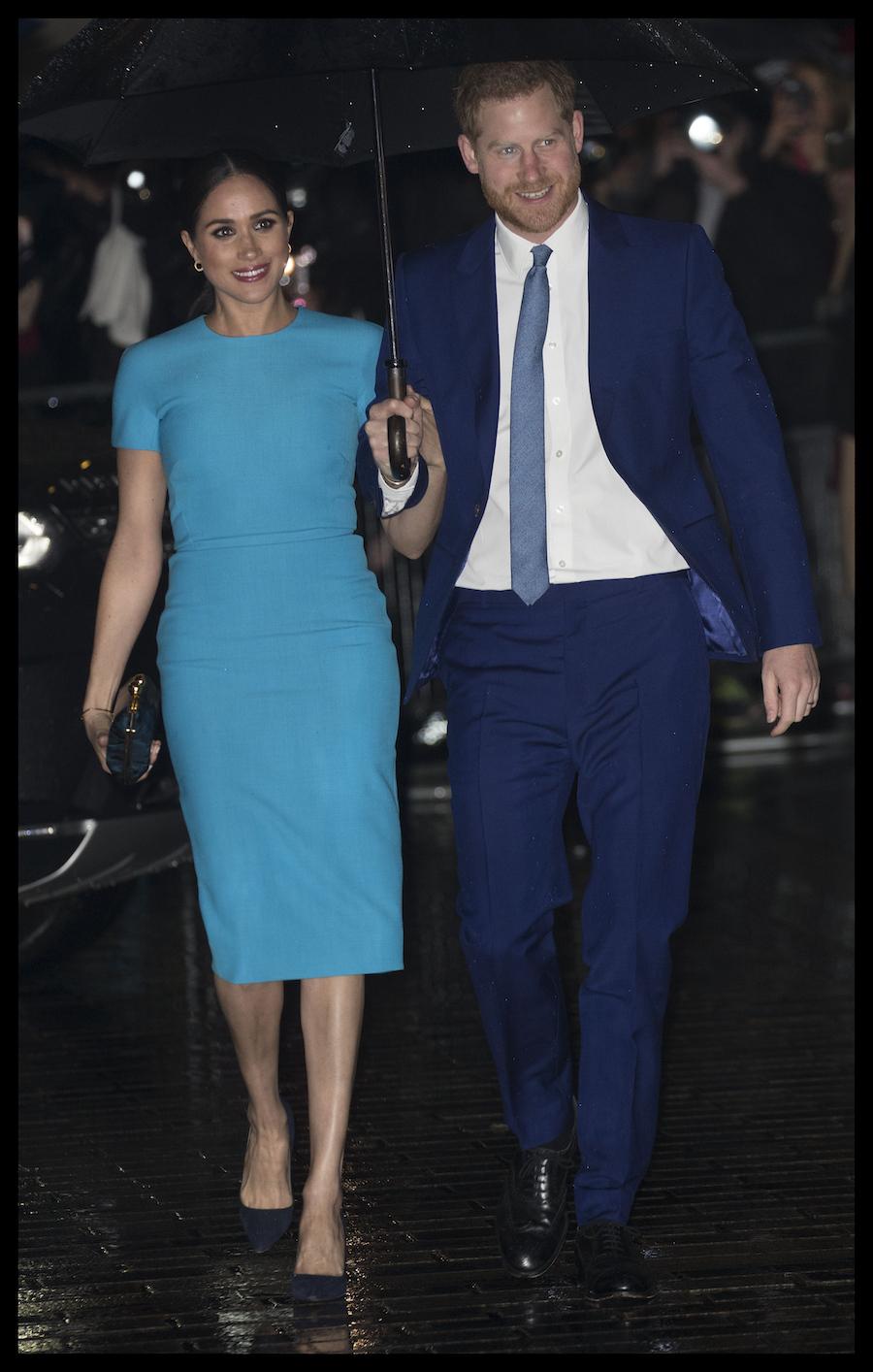 Książę Harry i Meghan Markle na wystąpieniu publicznym.