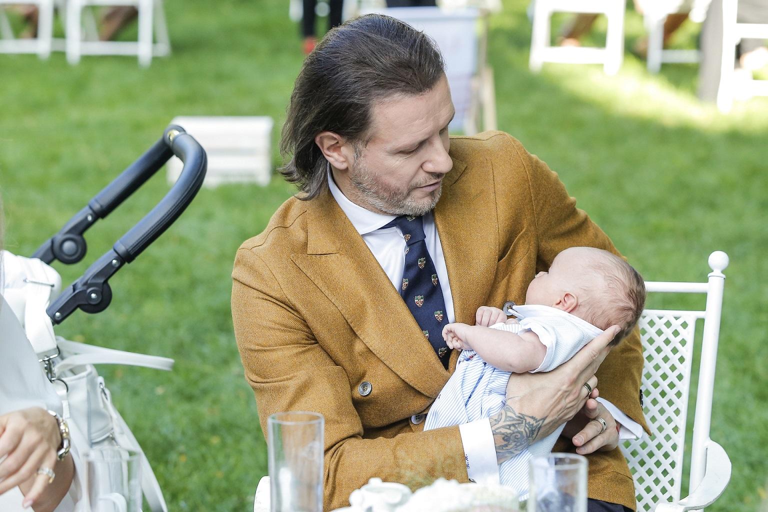 Radosław Majdan z synem Heniem pierwszy raz na salonach.