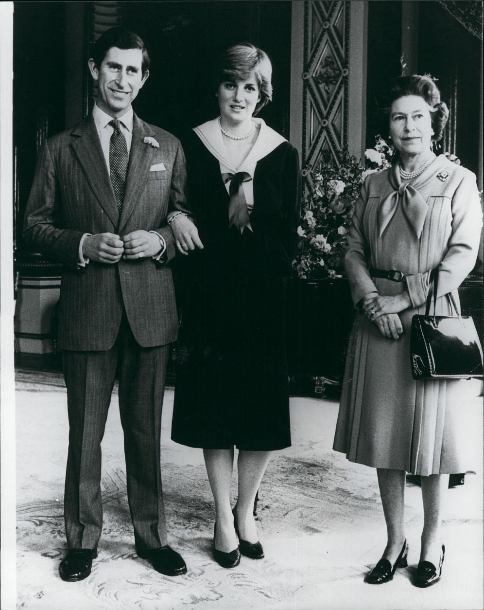Królowa Elżbieta II z Lady Dianą i księciem Karolem